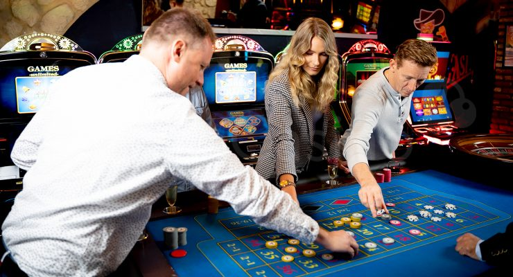 People playing roulette at land-based casino