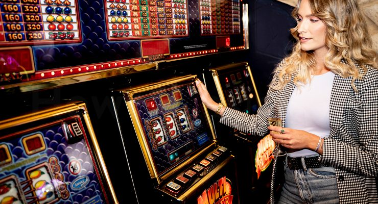 Young lady playing slot machine