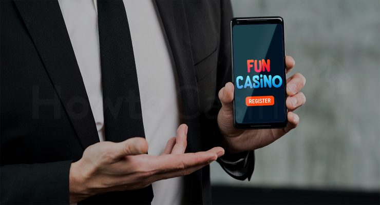 Man holding mobile with Fun Casino page