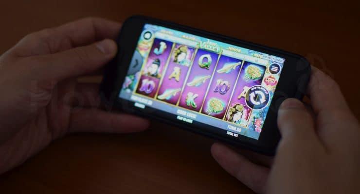 IPhone पर जेड वैली स्लॉट खेल रहा है