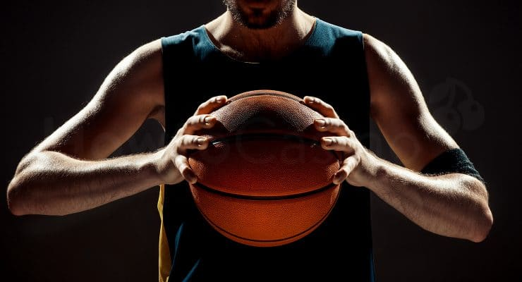 Basketball player holding the ball