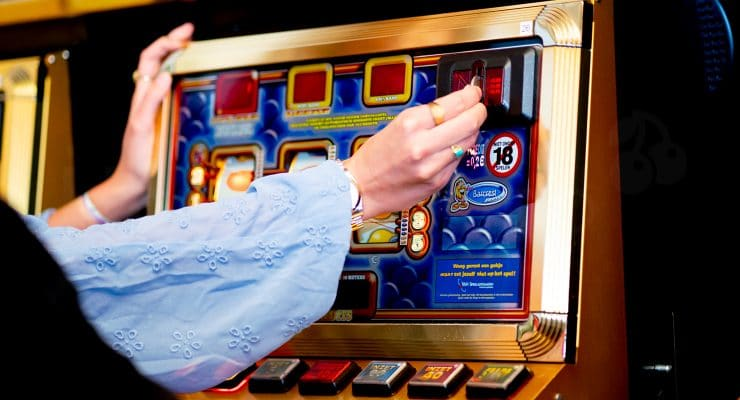 Putting the coin in the slot machine